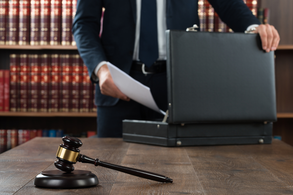 Is it illegal to threaten someone with a lawsuit?